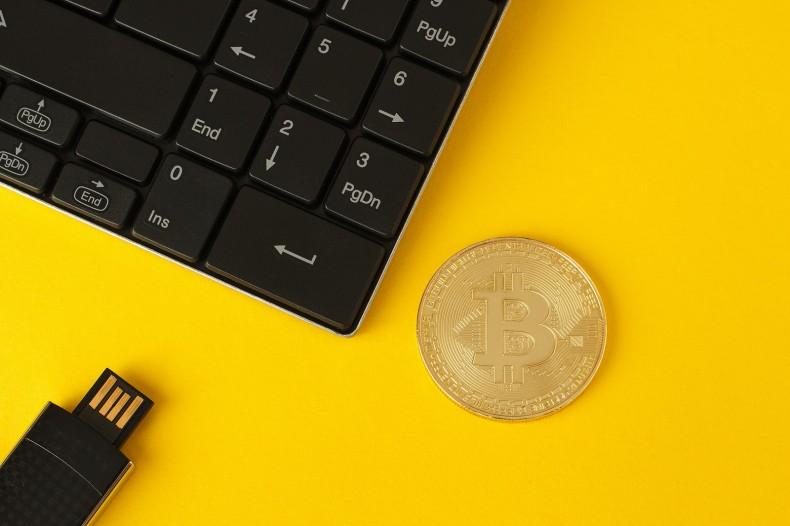 Gold coin with a bitcoin symbol.