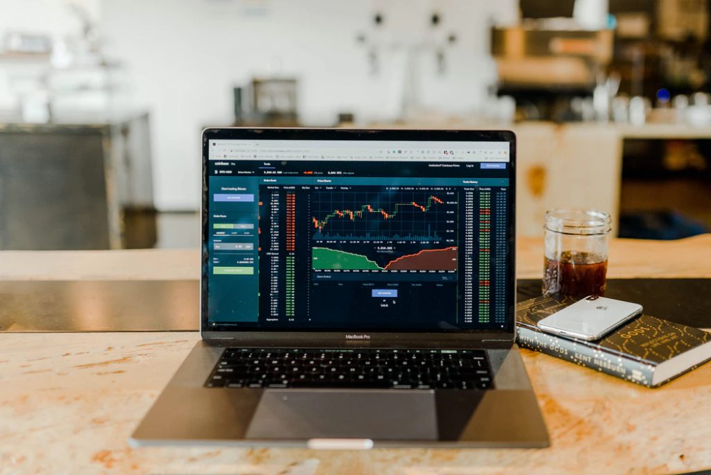 A laptop with trading charts open