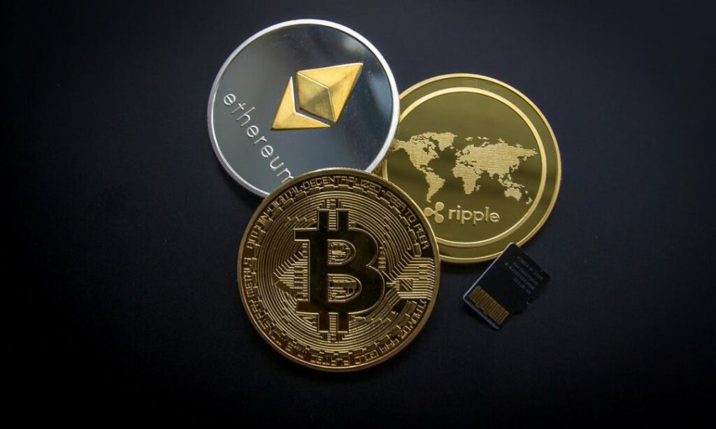 Three physical representations of bitcoin, Ethereum, and ripple cryptocurrency tokens.